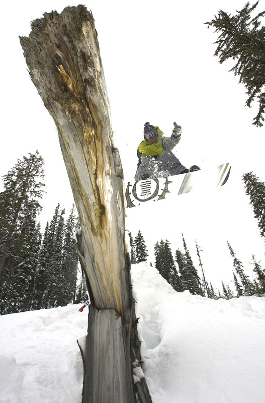 Derek Root taps the tree with his tail as he airs over it at Island Lake Lodge, Fernie, BC.