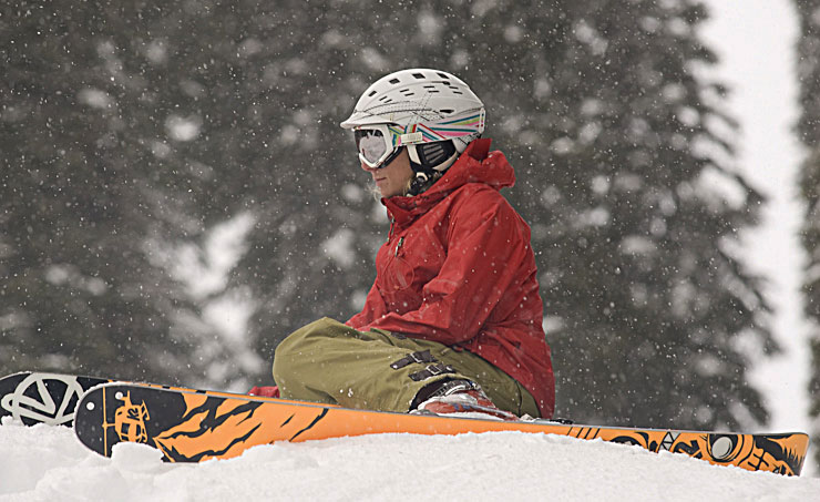 Janelle Miller takes in the tranquility of a winter snowfall at Island Lake Lodge, Fernie, BC.