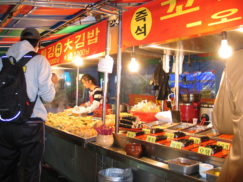 Street vendors are a comon sight in Gukje Market in Busan, South Korea. Vendors sell all sorts of food and brand name clothing at cheap prices.