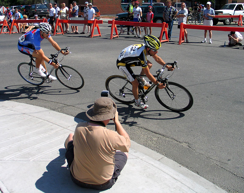 A photographer plies his trade as Jacob Erker and Jesse Collins ride one two as they comepete in the Bowness National Criterium Championships.