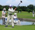 A man tees off on hole one of a park golf course in Honshu. Park golf is a sport very popular all over Japan, especially with the elderly. It is a combination of regular golf and mini golf, with a croquet flavour.