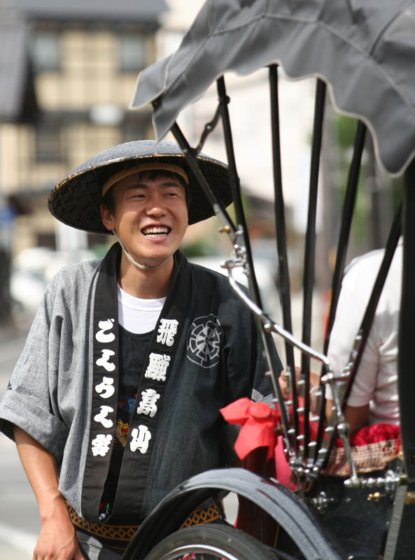 A rikshaw runner chats with his guests in Takayama, Honshu, Japan.