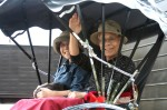 A Japanese couple gives a friendly wave as they pass in a rikshaw in Takayama, Honshu.