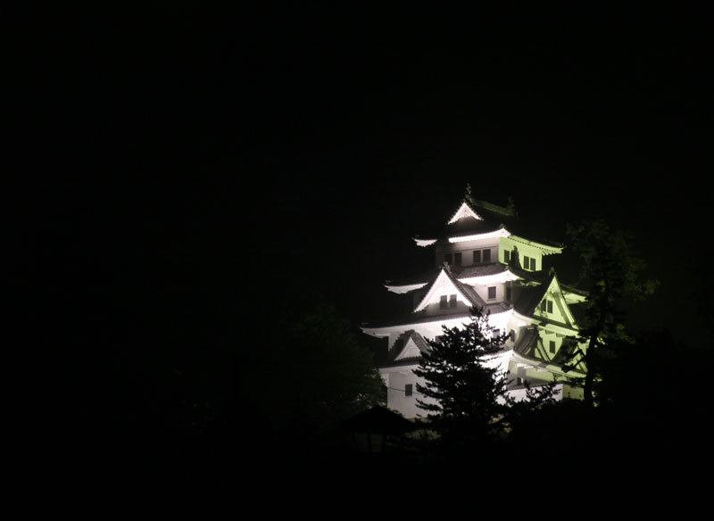 After riding 60 kilometres through the tail end of a typhoon, we were rewarded with a free camp spot and a clear view of Gujo-Hachiman castle in Honshu.
