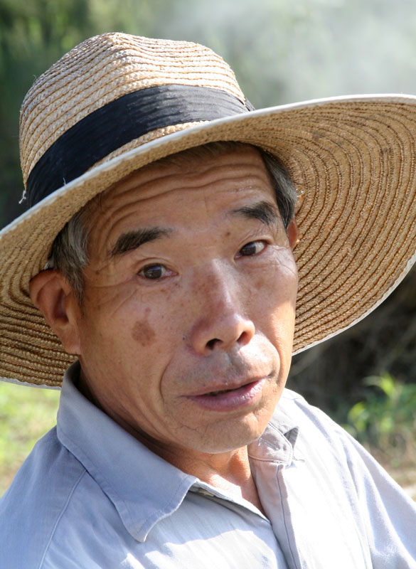 A farmer takes a time-out from burning off the excess vegitation in a rural area on Honshu.