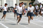 School kids run the 400 metre relay, the final event of sports day, in Sakawa, Shikoku. The kids train for months for the one day emotionally charged event.
