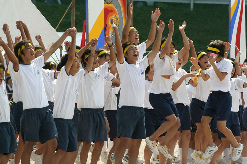School kids react with joy and elation after the posting of the results during sports day in Sakawa, Shikoku.
