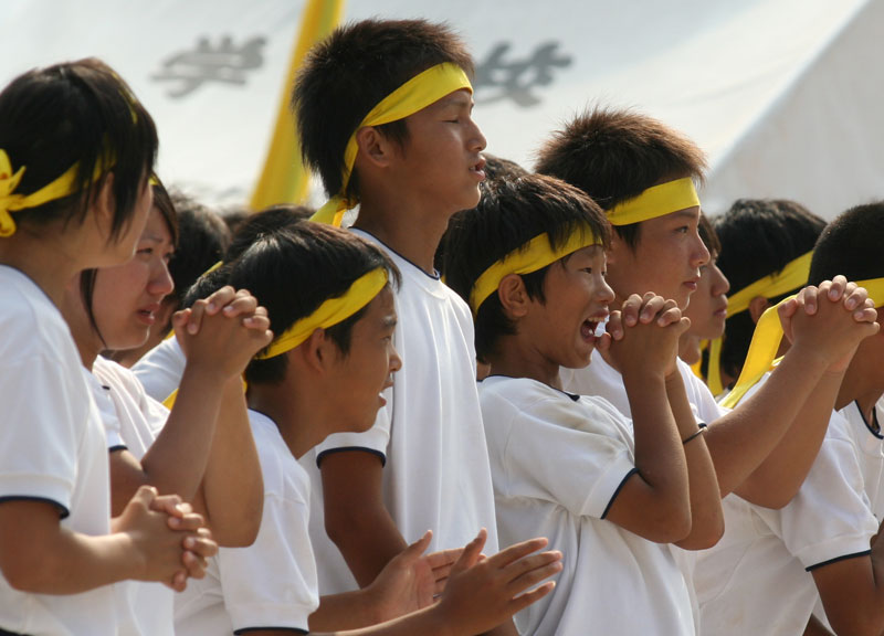 School kids clasp their hands in anticipation of the results during sports day in Sakawa, Shikoku.