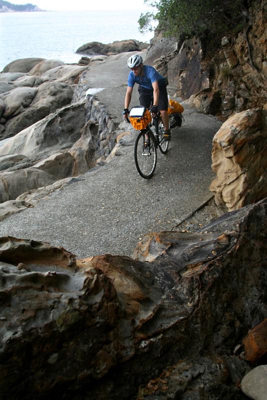 Reid McCord winds down a coastal pathway on the island of Shikoku.