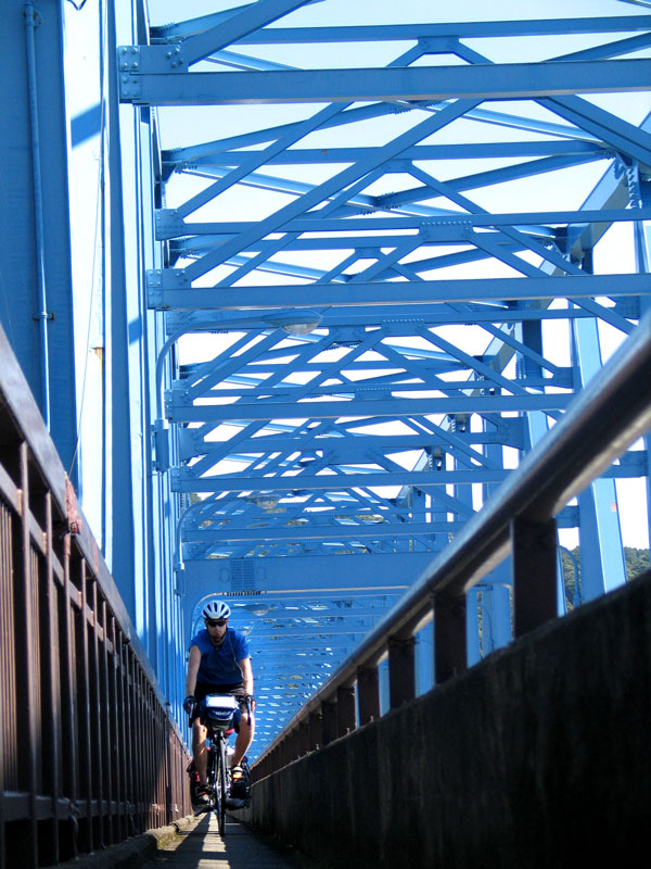 McCord rides the tight lines across a bridge.