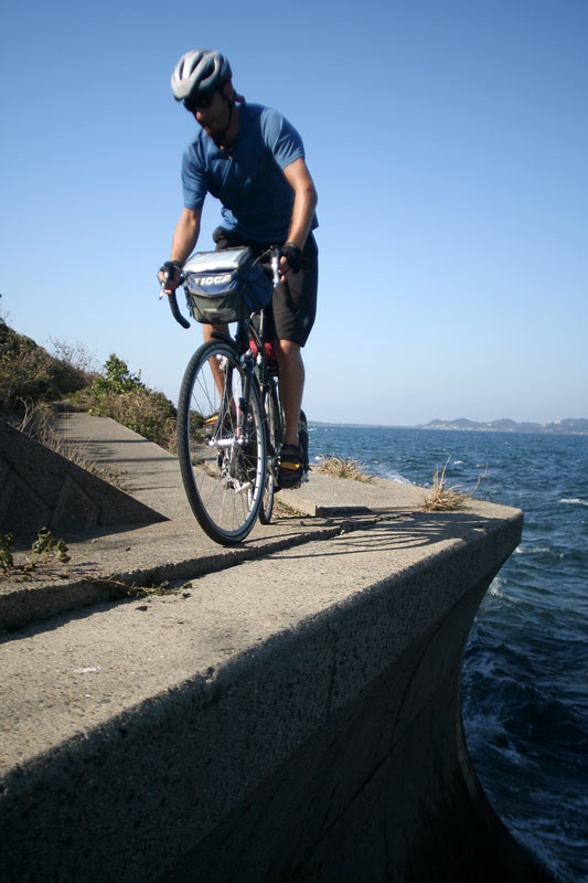 Reid McCord riding a breakwall on Amakusa-shimoshima Island in Kyushu.