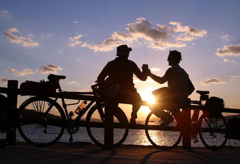 Beers and beautiful places were a common theme along the journey. Reid and Aaron enjoy the last sunset of the ride with a cold beer on the island of Kyushu.