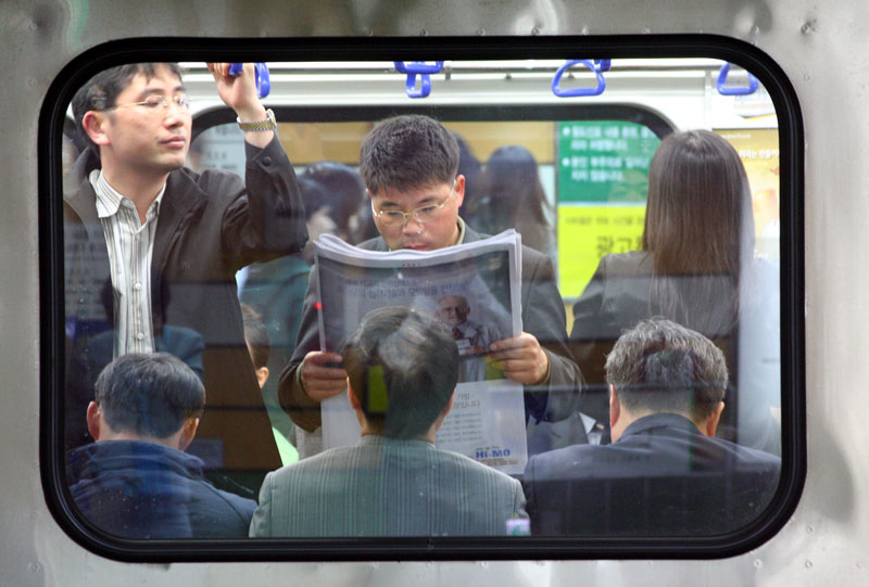 A window allows a look into the train culture in Busan, South Korea.