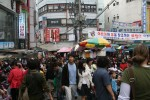 Large crowds walk through a market in Seoul in search of good bargains.