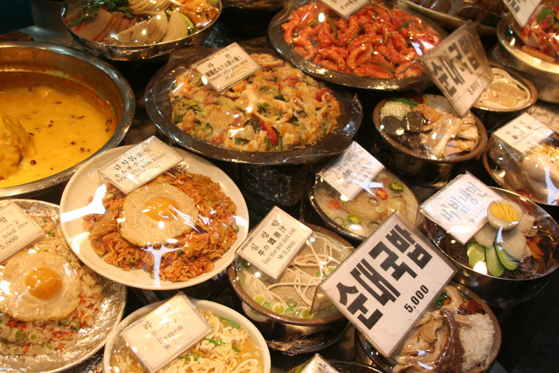 Dishes of replica food sit on display at a restaurant in a market in Seoul. The dishes represent menu items and pricing as to what is available in the restaurant.