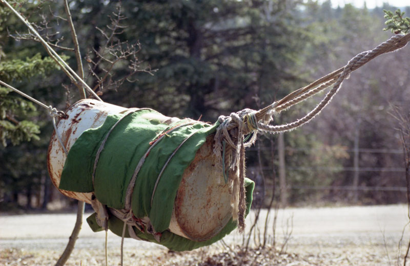 A barrell outfitted with a blanket and roped to near-by trees is the ideal training ground for any young cowboy.