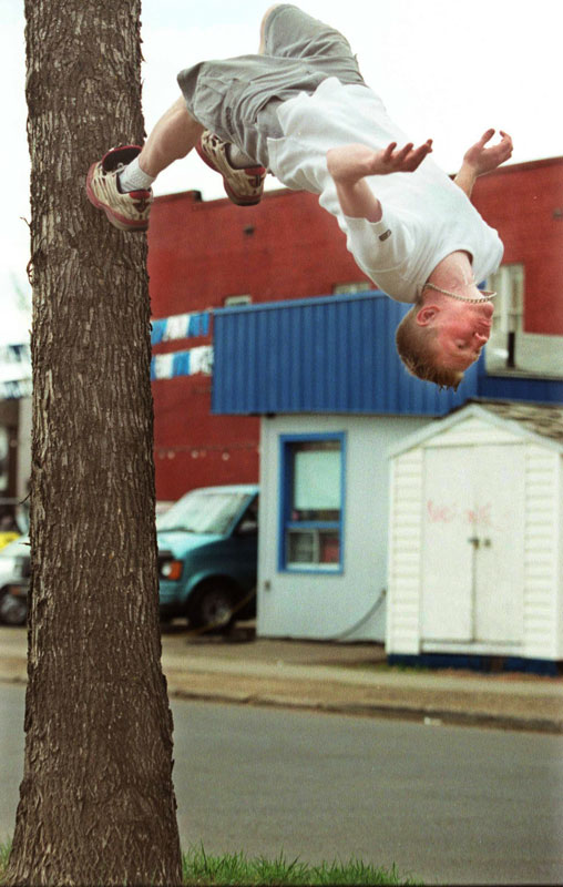 Brandon Dierich, 18 years old,  practices his running back-flips off a tree. Dierich first learned his back-flip technique off a swimming pool diving board before taking to the land where he wins bets from friends doing back-flips by running up and off of vertical objects.  He's even been known to drop a hat on the ground to encourage donations.Edmonton Sun Photo by Aaron Whitfield