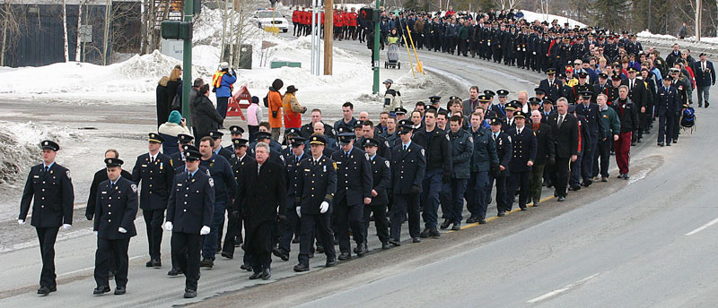The funeral procession for fallen fire fighter, Cyril Fyfe, included hundreds of firefighters, RCMP, corrections staff, municipal enforcement officers and others. They solemnly marched in formation during the 1.5 kilometre march up Franklin Avenue in Yellowknife NWT, Canada. Yellowknifer photo by Aaron Whitfield