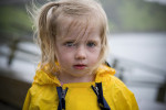 Two year-old Heidi Bedingfield, from Kodiak, walks near the city's rainy harbor.