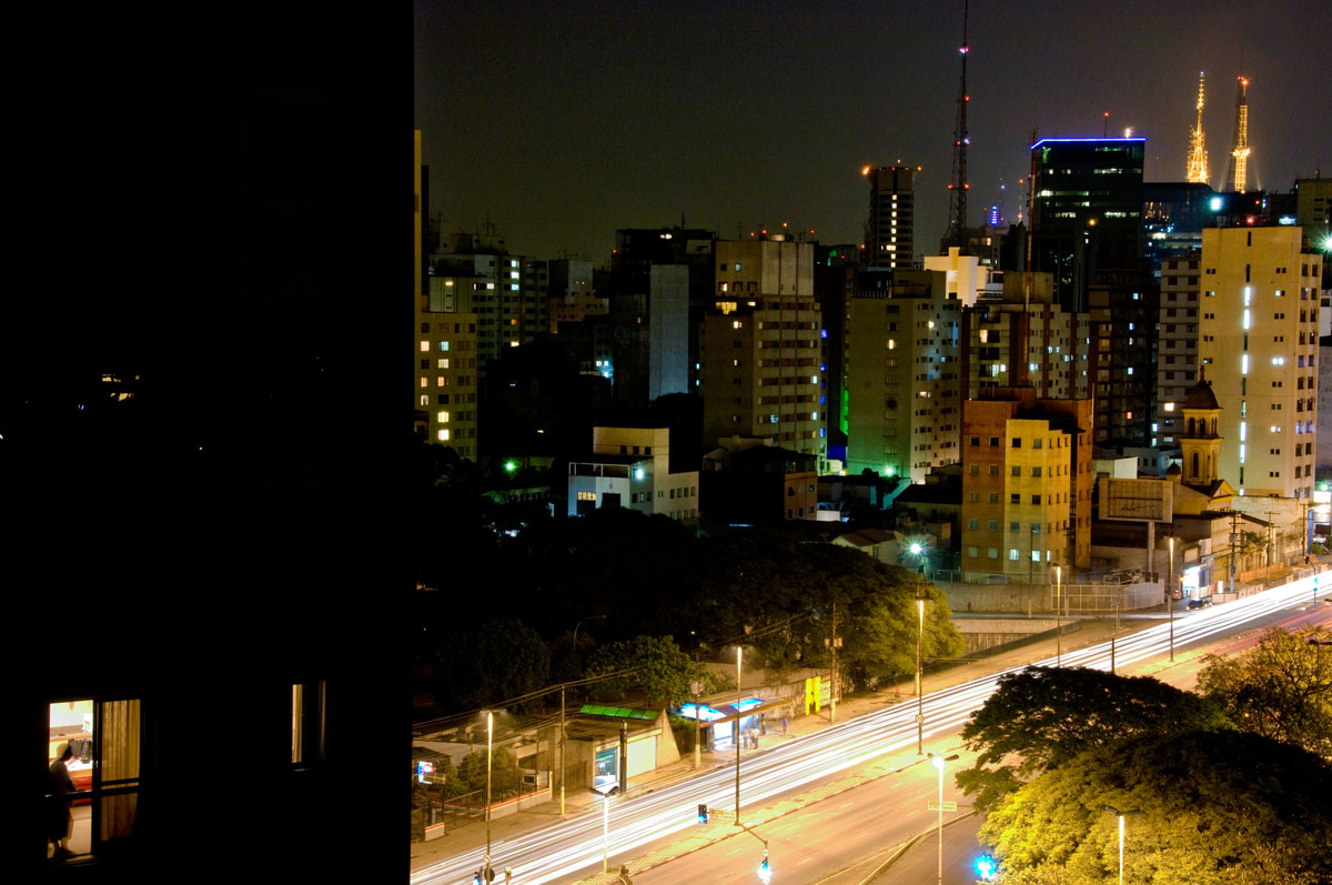 A lone figure watches the Sao Paulo skyline at night.©  Habitat for Humanity International