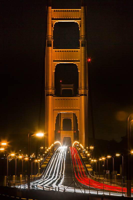 Traffic flows over the iconic Golden Gate Bridge.  Habitat for Humanity Greater San Francisco provides families with a springboard to secure, stable futures through affordable homeownership, financial literacy and neighborhood revitalization.