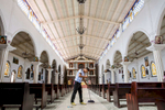 A man sweeps the floor in the Catholic Church of San Juan La Laguna, in the highlands of Guatemala near Lake Atitlan.© Habitat for Humanity International/Ezra Millstein