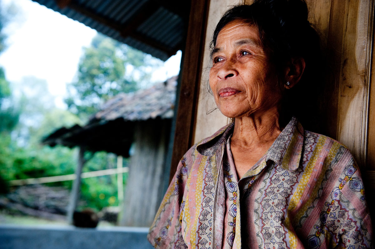 Wayan Srikasih has lived in this Habitat home since 2011.  Her previous house is a dilapidated shack, which stands next door and serves as a constant reminder of how her life has improved.  © Habitat for Humanity International/Ezra Millstein