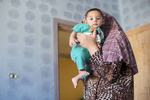 Ahmed Hariri is five months old. He was born in Jordan, after his family fled the bloodshed in Syria in 2011.  Jordanians say that they feel like the refugees are brothers and sisters, and it is important to them to care of them.© Ezra Millstein