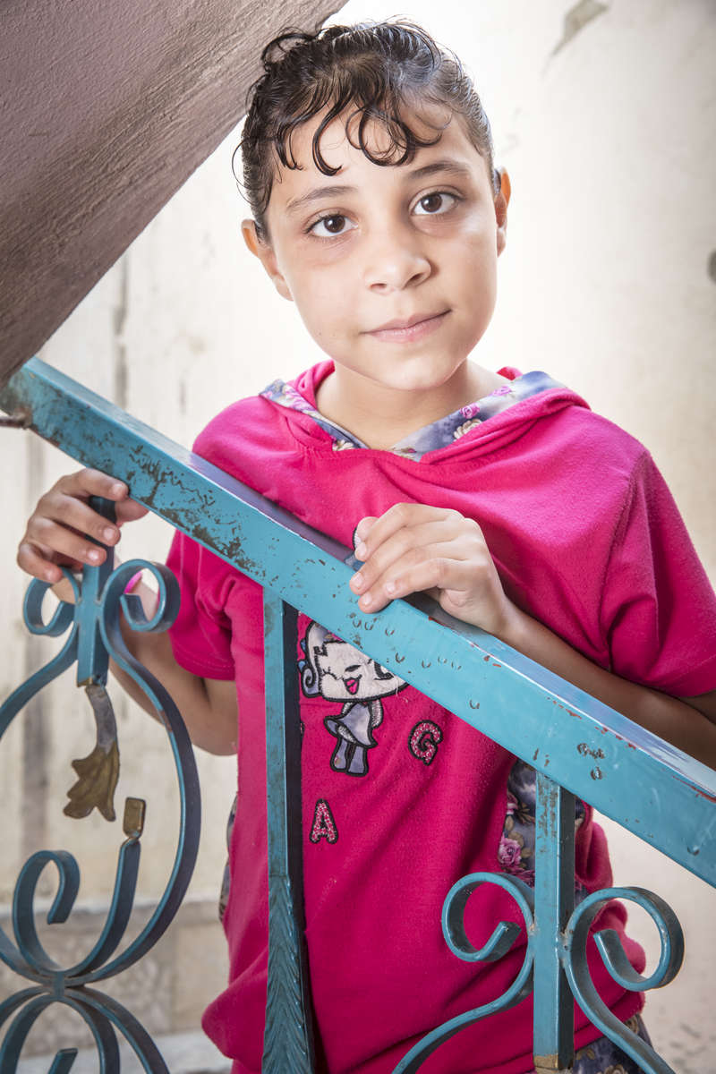 6 year-old Asaleh Ralrfaea and her family fled Syria in 2012 when their home was destroyed.  They spent three days traveling across the border to Jordan, with whatever possessions they could carry.  They have no interest in returning to Syria.© Ezra Millstein