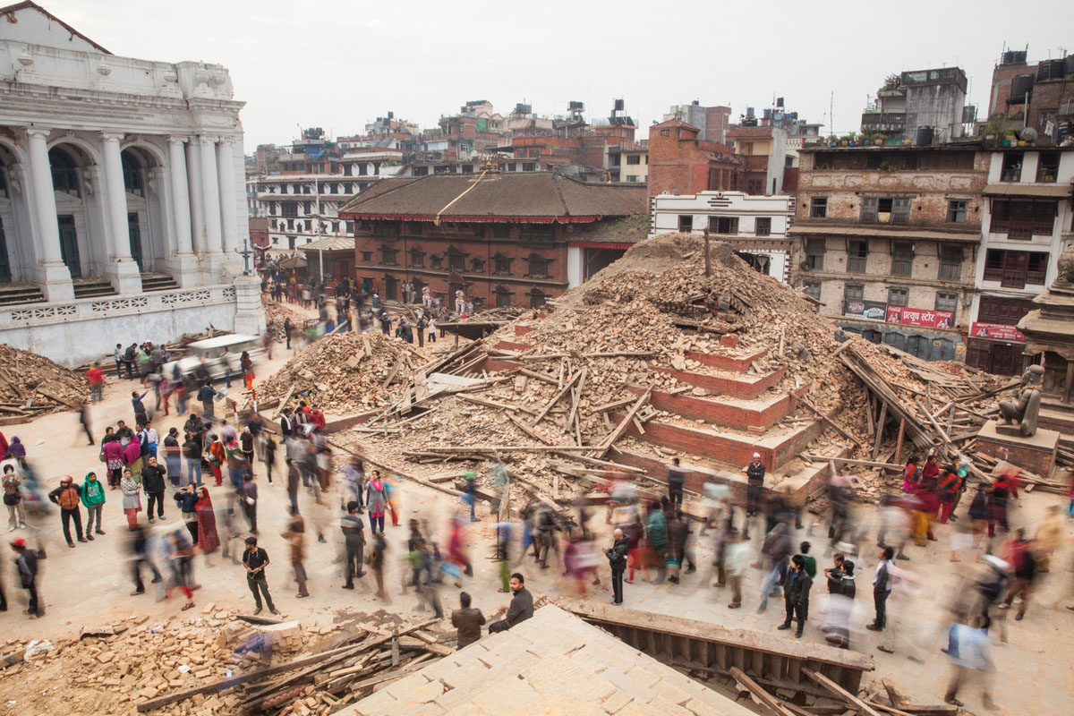 The temples in Durbar Square, the cultural center of Nepal, are in ruins, the morning after a huge 7.8-magnitude earthquake struck Nepal, and was felt as far as India and Pakistan.  A series of aftershocks continued to strike fear into residents, who were sleeping outside in streets and parks for fear of collapsing buildings. © Habitat for Humanity International/Ezra Millstein