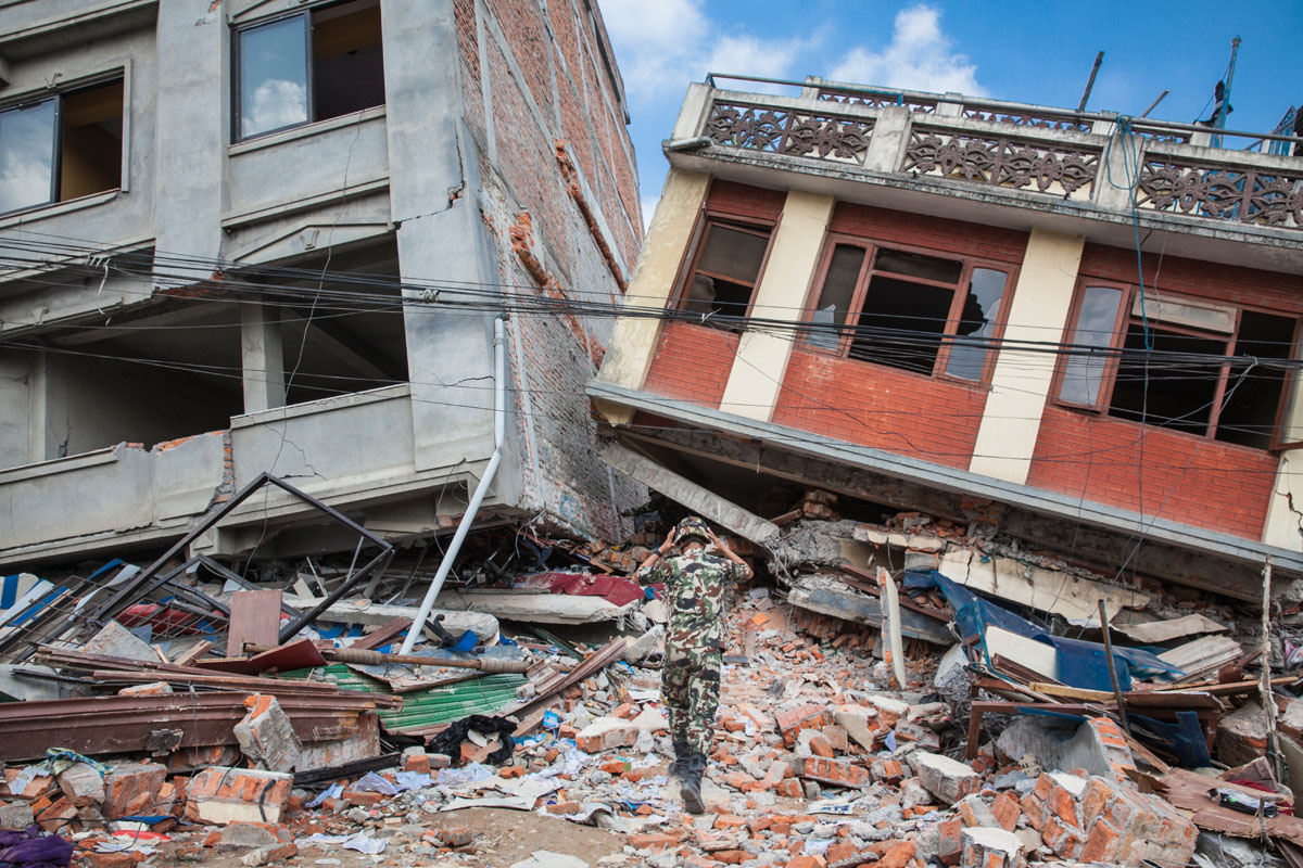 KATHMANDU, NEPAL (4/27/15)-A Nepali recovery team prepares to remove a dead body from a collapsed building, two days after a huge 7.8-magnitude earthquake struck Nepal, and was felt as far as India and Pakistan.  © Habitat for Humanity International/Ezra Millstein