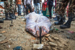 A Nepali recovery team removed a dead body from a collapsed building, two days after a huge 7.8-magnitude earthquake struck Nepal, and was felt as far as India and Pakistan.  © Habitat for Humanity International/Ezra Millstein