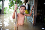 A boy wades through floodwater next to his house, as Typhoon Mirinae batters the Philippines.  Mirinae was the fourth storm to strike the country in a month.© Habitat for Humanity International/Ezra Millstein
