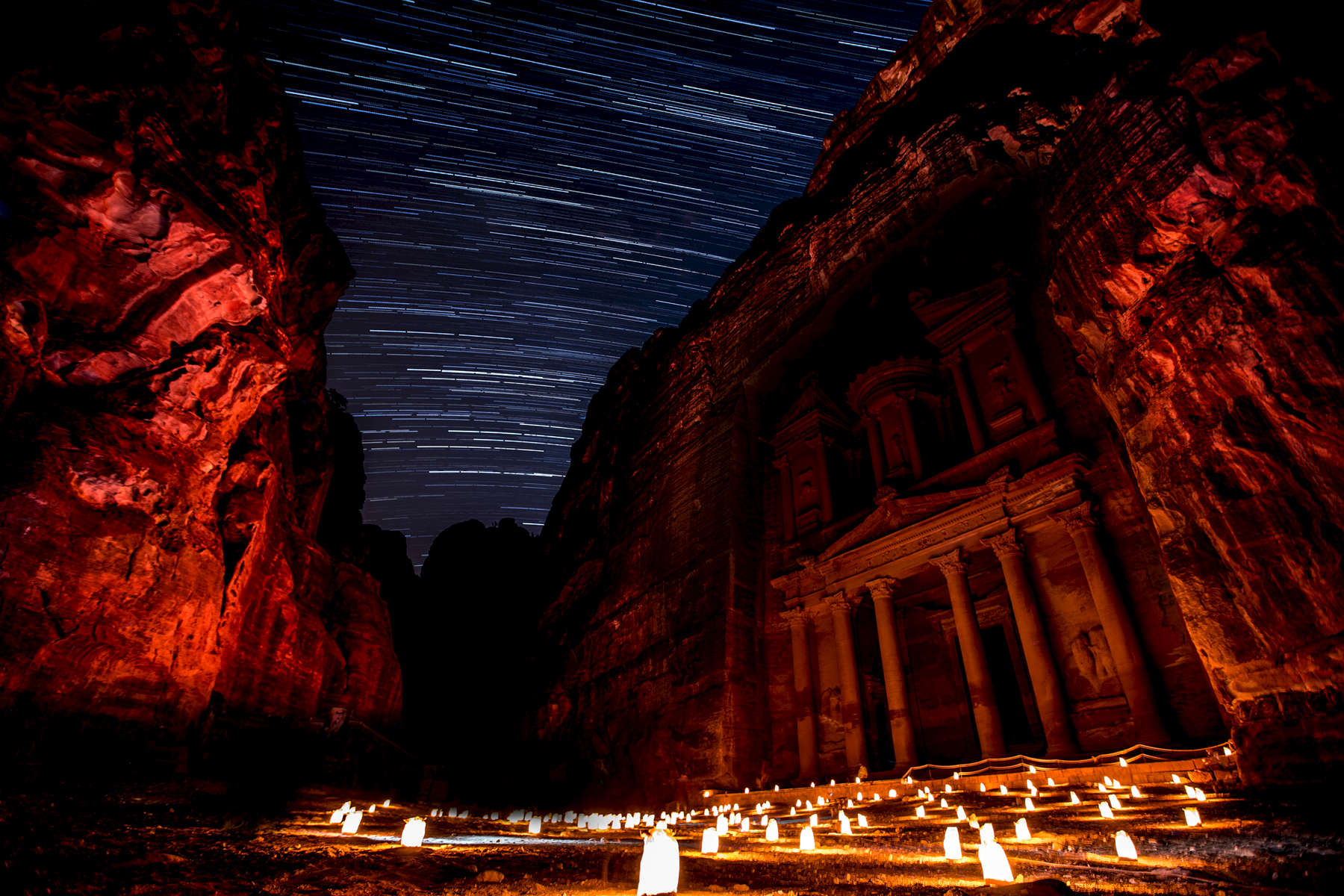 Al Khazneh, or the Treasury, was carved out of a sandstone rock face. It is one of the most elaborate temples in Petra, and is otherworldly at night.