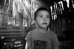 4 year-old Franklin Rojo stands in his family's smokey kitchen.  Habitat for Humanity volunteers helped to build a new kitchen with better air circulation, which will improve thie respiratory health.© Habitat for Humanity International/Ezra Millstein