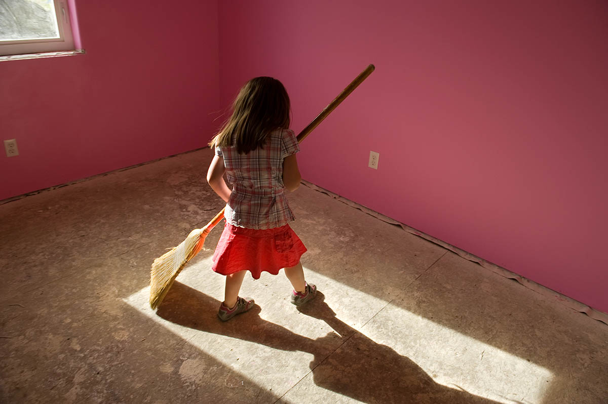 Five year-old Acacia Johnson carefully sweeps the floor of her soon-to-be bedroom, in her family's new Habitat house.   Acacia lived with her mother Maryann and three year-old sister Amaya in a small home in Fairbanks, until they moved into this new three-bedroom Habitat home in July 2008.  It keeps them warm during the long Alaskan winters.  The girls have already found a way to combat the darkness of winter in the 49th state, by painting their bedrooms pink and purple.© Habitat for Humanity International/Ezra Millstein