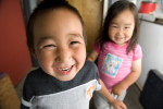 Two native Alaskan children live in a run-down trailer park in Anchorage.  Several families have moved from these mobile homes into Habitat houses.©  Habitat for Humanity International