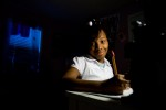 Nine year-old Destiny Jackson sits at a desk in her room, doing her homework.  She and her mother Deirdre Jackson, a schoolteacher, lived in New Orleans East before losing everything to Hurricane Katrina.  {quote}We had nothing to go back to,{quote} said Deirdre, who has resettled in Jackson, Mississippi, in a house built in partnership with Metro Jackson Habitat for Humanity.  She shares her home in the Poindexter Park neighborhood with Destiny, her 16-year-old nephew, Patrick, and two tuxedo cats, Adam and Eve.© Habitat for Humanity International/Ezra Millstein