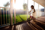 Abianna Predaleus plays behind her family's Habitat home; its construction was made possible with the help of Federal NSP2 funds.© Habitat for Humanity International/Ezra Millstein