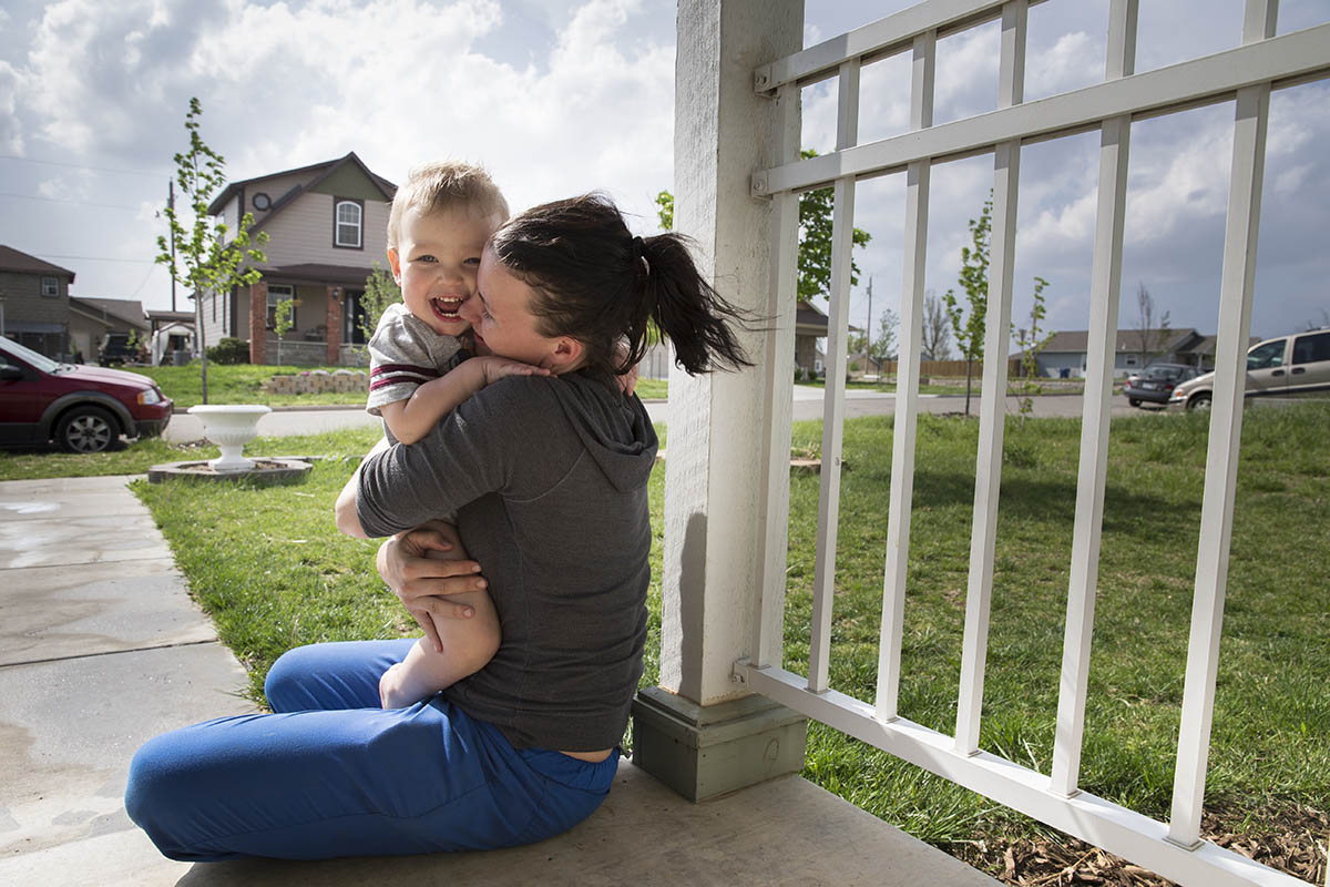 Samantha Short and her two year-old son Thomas moved into a FEMA trailer after an EF-5 tornado struck Joplin on May 22, 2011.  They partnered with Joplin Area Habitat for Humanity to build their own four-bedroom home in 2011.©Habitat for Humanity International/Ezra Millstein
