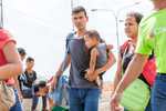 Families cross the Venezuela-Colombia border at Paraguachón, Colombia. The border is fluid, with people moving in both directions. Some Venezuelans enter Colombia for as little as a day — long enough to get one meal — up to several weeks or months, to work and stock up on supplies before returning home. Others arrive with suitcases and anything else they can carry, and may stay indefinitely. Colombians also enter Venezuela through this crossing, to purchase items that are still available at significantly cheaper prices there. In the week before this visit between 400 and 800 people crossed into Colombia every day through the crossing at Paraguachón, while around 200 crossed into Venezuela. These numbers don't account for people crossing at any of the 200 illegal crossing sites in La Guajira. In total, more than 1 million Venezuelans have fled to Colombia, fleeing economic, governmental and social collapse that has plunged the majority of the population into poverty, joblessness and near starvation.