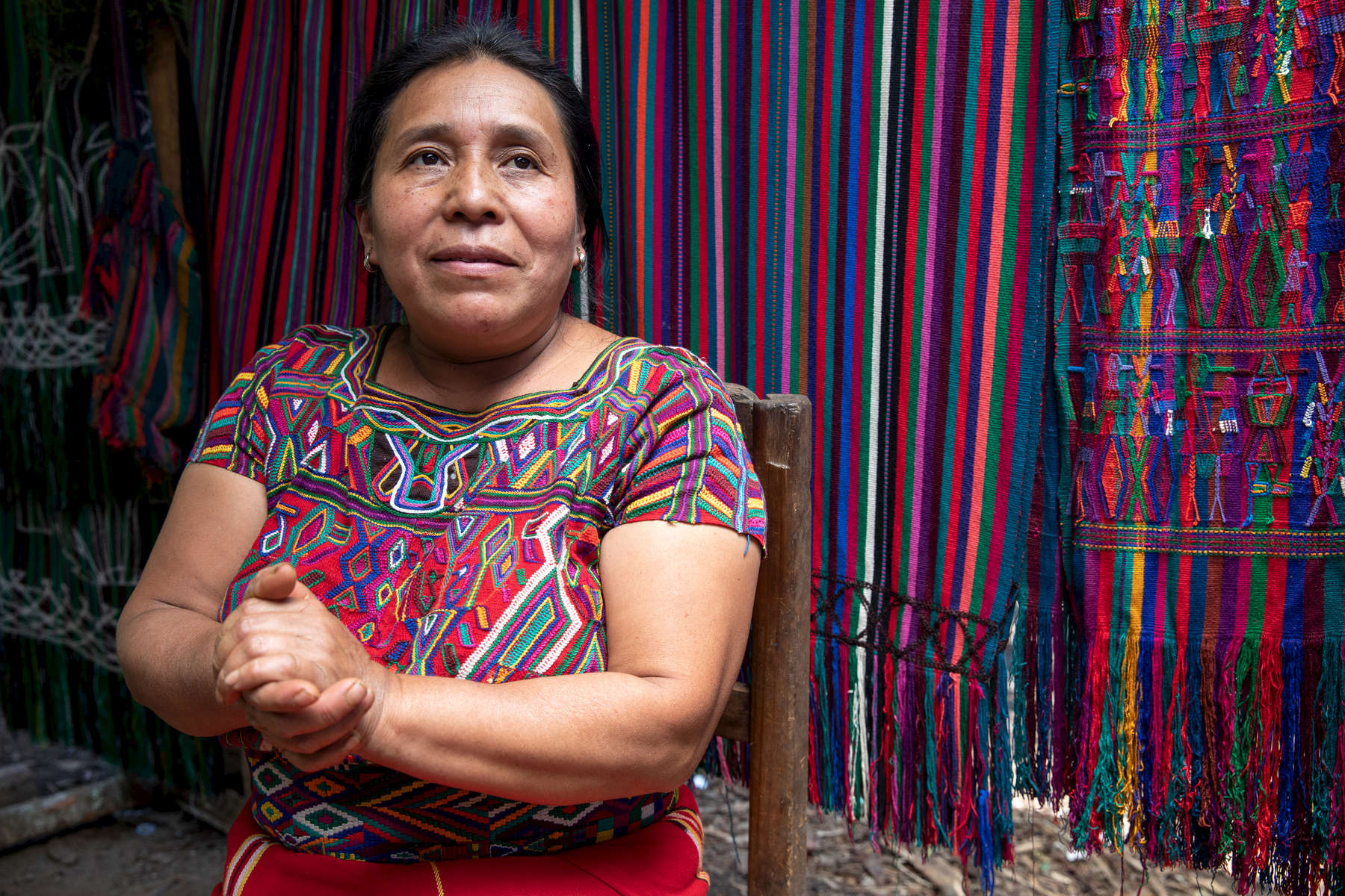 "Maria de León Santiago lives with her children and grandchildren in a small community in Guatemala's Western Highlands, an agricultural region characterized by underdevelopment, malnutrition, poverty and a lack of opportunity. She says the needs are immense here — water, sanitation, shelter, food, jobs, etc. — and she often struggles to support her family with farming and weaving. Because of this, migration is a fact of life for Maria — her husband leaves every year to work in a sugarcane plantation to earn money. It's not what they want, she says, but it's the only way they can feed their children. Maria has recently started saving for the first time ever through the ""Communities Leading Development"" program, which is implemented by local partners with technical support from Mercy Corps. The program aims to improve quality of life for families in 200 communities in the Western Highlands, in part by installing community savings and loans groups to build financial stability. Maria is the president of her savings and loan group, and she says she is focused solely on saving right now, so she can give her family a better life than she had growing up."