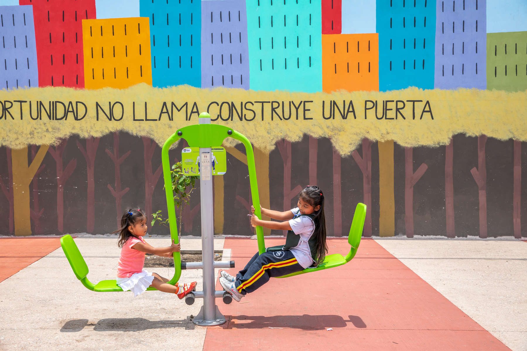 Alejandra (green shirt, 5) and her sister Sofia (pink shirt, 2) play in a park Mercy Corps built in their community. These infrastructure projects — playgrounds, exercise areas, community centers — are part of Mercy Corps' CONVIVIMOS program, which is working in Guatemala City's most violent areas to promote cohesion and help people reclaim their communities. The spaces offer families important neutral territory in places otherwise driven by territory-based gang violence, and offer them the opportunity to experience and feel rooted in their communities in a more positive way.