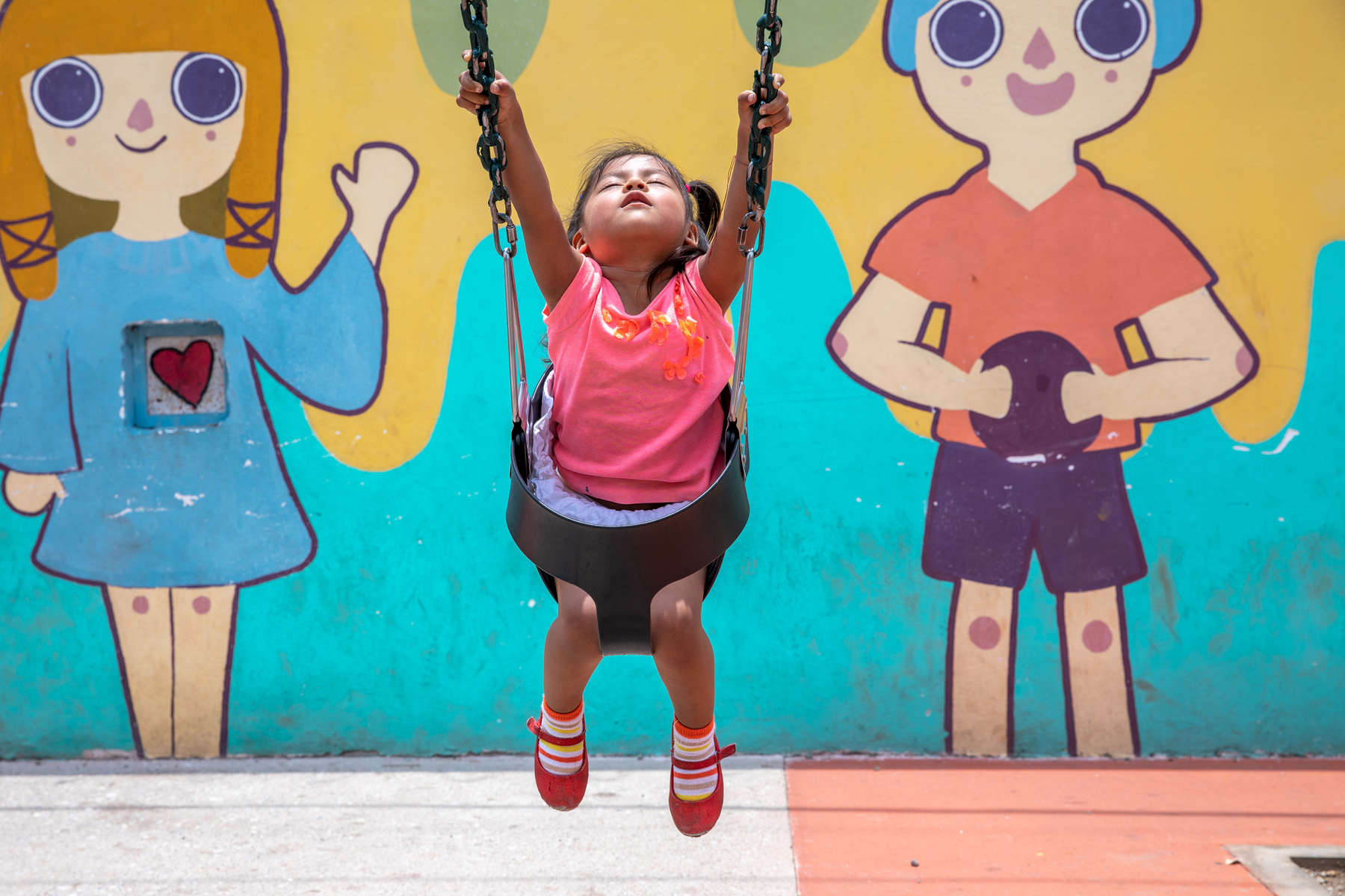 Sofia, 2, plays on a swing in a park Mercy Corps built in her community. These infrastructure projects — playgrounds, exercise areas, community centers — are part of Mercy Corps' CONVIVIMOS program, which is working in Guatemala City's most violent areas to promote cohesion and help people reclaim their communities. The spaces offer families important neutral territory in places otherwise driven by territory-based gang violence, and offer them the opportunity to experience and feel rooted in their communities in a more positive way.