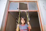 Shahad Moatez Hashem, 5, plays on an improvised swing. She lives with her grandmother, Faiza Abdulrazak Aziz. Faiza and her extended family fled from ISIS. There is nothing left at their house; their car was burned and their home was destroyed. They share a home with five families. She has six children, three boys and three girls, and six grandchildren living in the shared house.The family received a $400 cash distribution from Mercy Corps. Cash assistance is the quickest and most efficient way of helping because people can buy what they and their families need most. Since July 2016, Mercy Corps has helped more than 12,000 families impacted by conflict around Mosul.