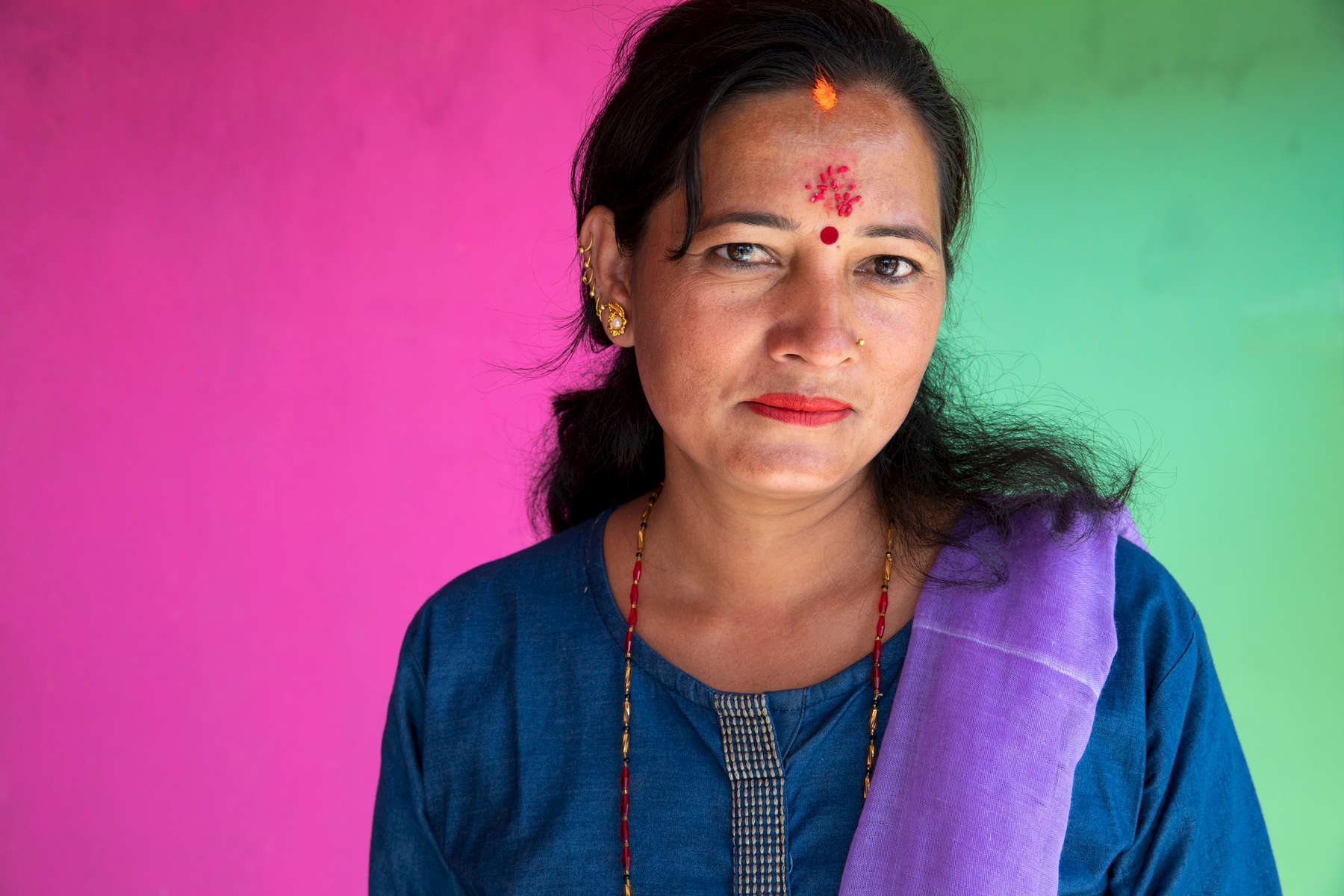 Dil Kumarf Poudel, 35, cares for her two children and runs her household alone, as her husband has migrated to Malaysia to work as a daily wage laborer. Livelihood opportunities are scarce here, especially for girls, who face incredible barriers to education and income generation, including the pressure to marry early, unequal household responsibilities, and a lack of familial support. Dil married at 15 — while in grade 8 — but continued her studies, even though it was difficult. However, after she failed her grade 10 exam and got pregnant, she dropped out completely, instead tending to her children full time and supporting them with them with agricultural work. She regretted not completing her education and felt her life could never improve. (The grade 10 exam is equivalent to a high school diploma and is required for higher education or skilled work.)Mercy Corps' STEM program supports out-of-school girls age 16-30 with life skills education, financial literacy classes and access to loans, so they can build better livelihoods and improve their lives. Dil began attending the program meetings several years ago, a move that transformed her view of herself and helped her build the confidence to retake her grade 10 exam and complete her education. With her grade 10 certification, she has been able to take a position on the board of the local school and now works to improve its facilities and ensure students get the education they deserve.