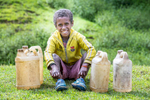 "Moises Lopes, 10, rests after collecting water in the central highlands of Timor-Leste.  His village has benefitted from Mercy Corps programs. Americo Pereira, 45, is a community leader from Mulo. He says that Mercy Corps M-RED program has benefitted the village tremendously. ""I'm really thankful and happy for all the things that the Mercy Corps M-RED program has done for us. Before, we didn't have any knowledge of farming techniques, but because of the Mercy Corps intervention, now we understand and know how to use techniques to make sure that we have a good plantation and a good harvest.""Farming in Timor-Leste depends on the dry and rainy seasons. Because of climate change, the dry seasons are longer and the rains are harder to predict. That leaves farmers with less to feed their families.Hunger is a serious problem in Timor-Leste, where most families in the rural mountains depend on farming to survive. Mercy Corps is helping farmers manage their own farmers groups, where local communities pull together rather than work alone."