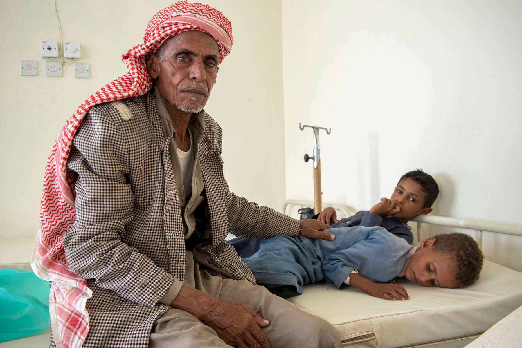 "When Khalid's younger son, Mohammed, fell severely ill from cholera, he carried him for two hours on his back through the mountains to receive treatment. His 10-year-old son Ali is also sick. Mercy Corps is providing cholera clinics in Yemen with beds, IV fluids and water to help them meet the increasing needs of patients like Mohammed. ""They are providing us with everything, as I have nothing,"" Khalid says of the clinic. ""Whenever one of my family members get sick, I just bring them here."""