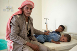 """When Khalid's younger son, Mohammed, fell severely ill from cholera, he carried him for two hours on his back through the mountains to receive treatment. His 10-year-old son Ali is also sick. Mercy Corps is providing cholera clinics in Yemen with beds, IV fluids and water to help them meet the increasing needs of patients like Mohammed. """"They are providing us with everything, as I have nothing,"""" Khalid says of the clinic. """"Whenever one of my family members get sick, I just bring them here."""""""