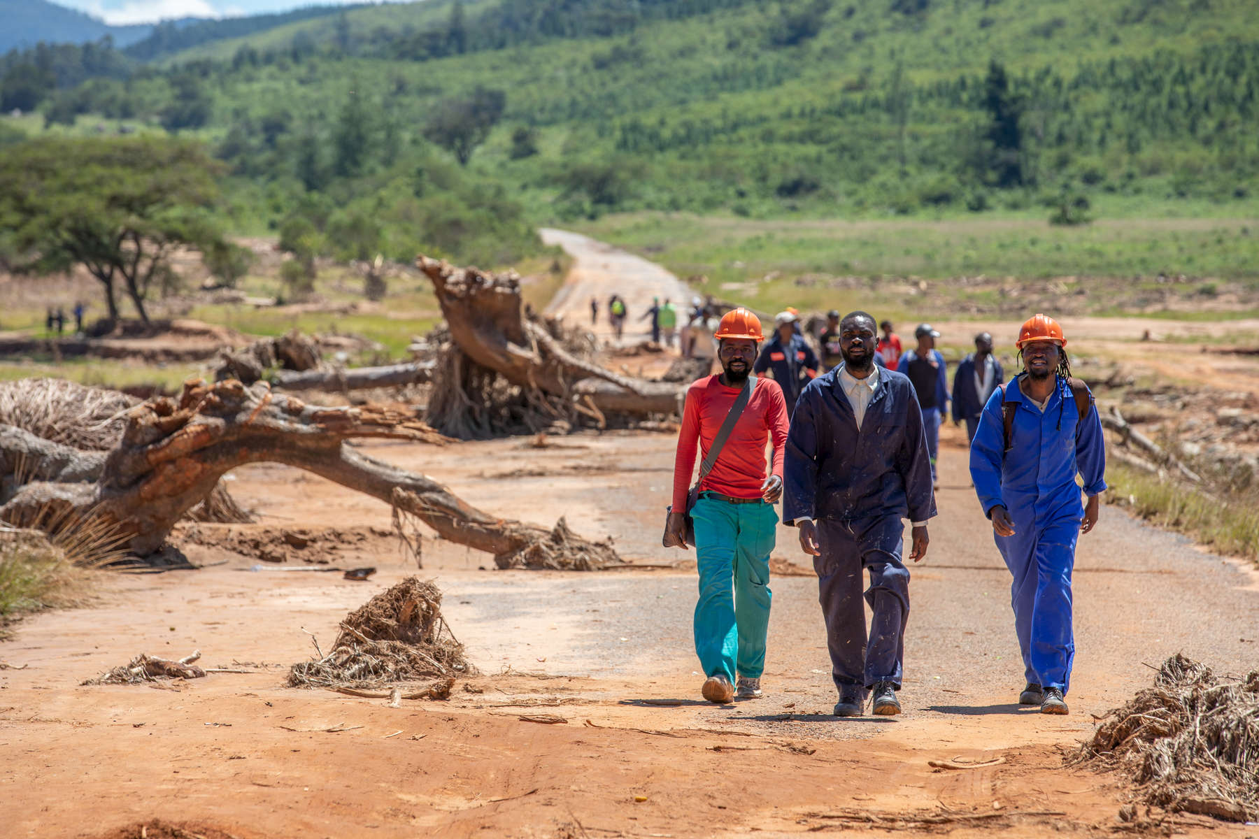 Utility workers walk across the remains of a bridge over the Nyahodi river, which burst its banks and washed away an entire market full of stalls, vendors and customers. It is estimated that 14 bridges around Chimanimani were destroyed, paralyzing transportation and making aid delivery slow and treacherous.
